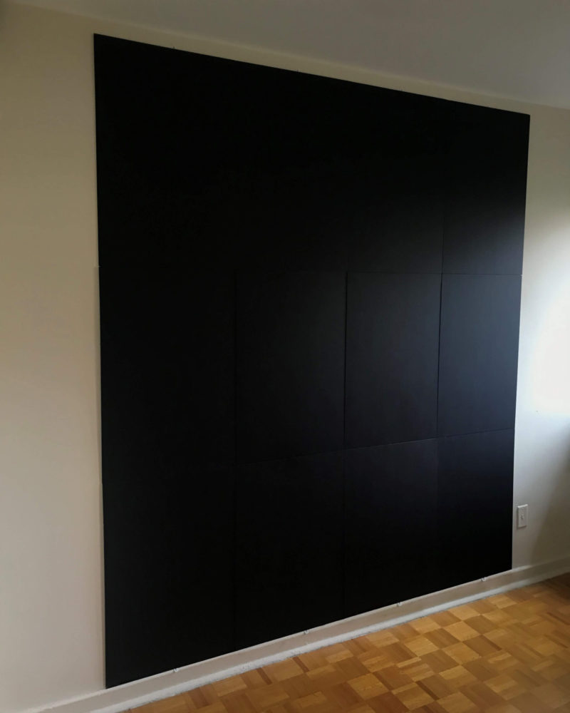 Black backdrop panels viewed from front left