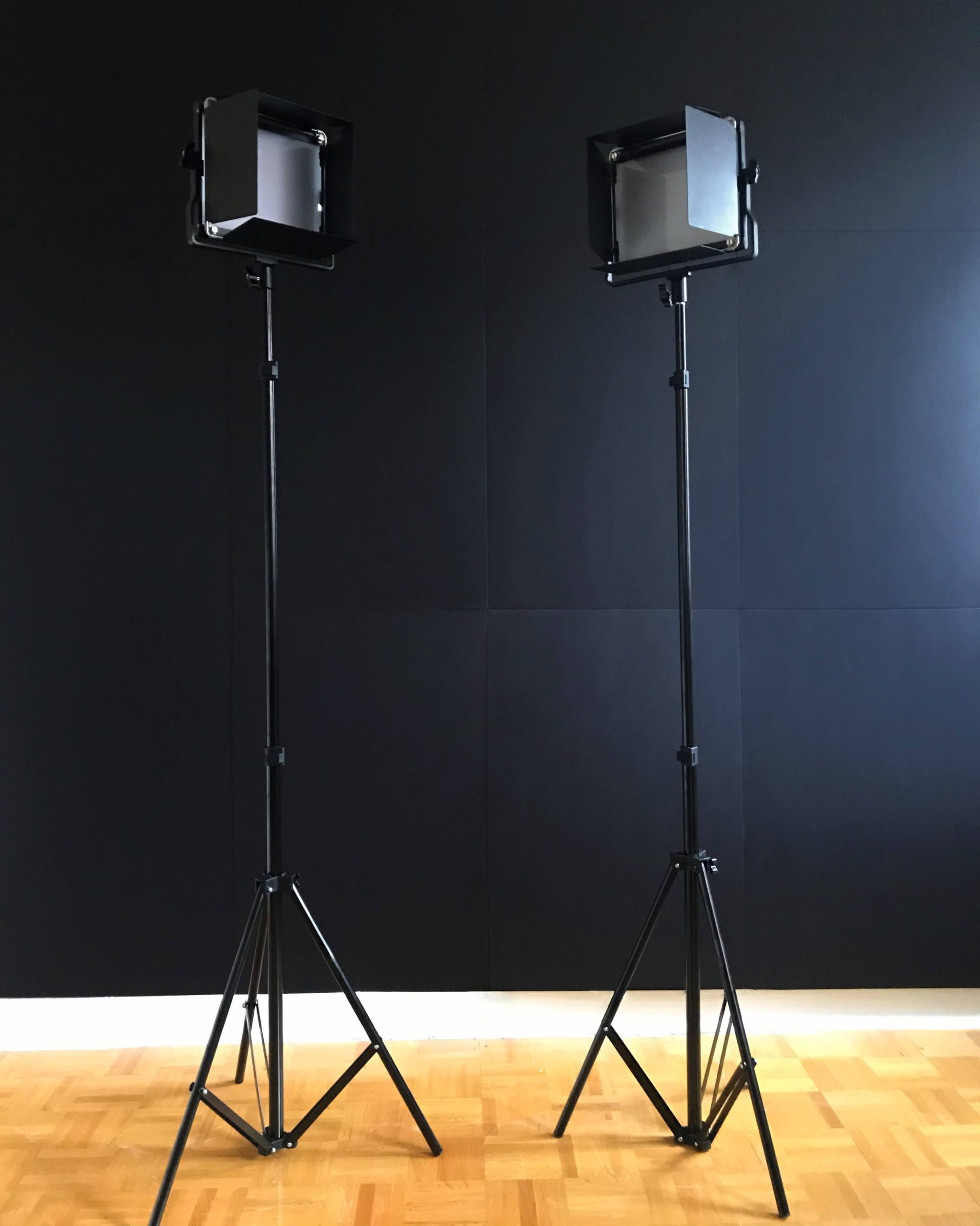 Lightboard presenter lights in front of the black backdrop panels
